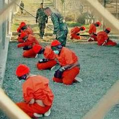 TOUT JUSTE INVESTI Barack Obama réclame la suspension des procédures judiciaires à Guantanamo