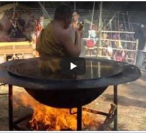 VIDEO - Un Moine Bouddhiste Défi Les Lois De La Physique En Méditant Dans Un Récipient D'huile Chaude Sur Le Feu